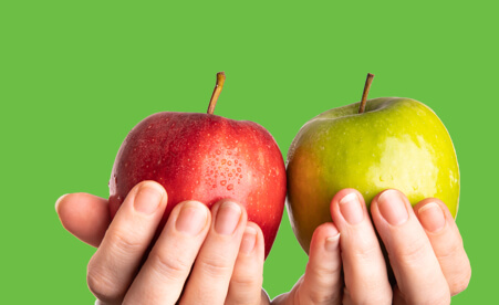 Image containing hands holding red and green apples